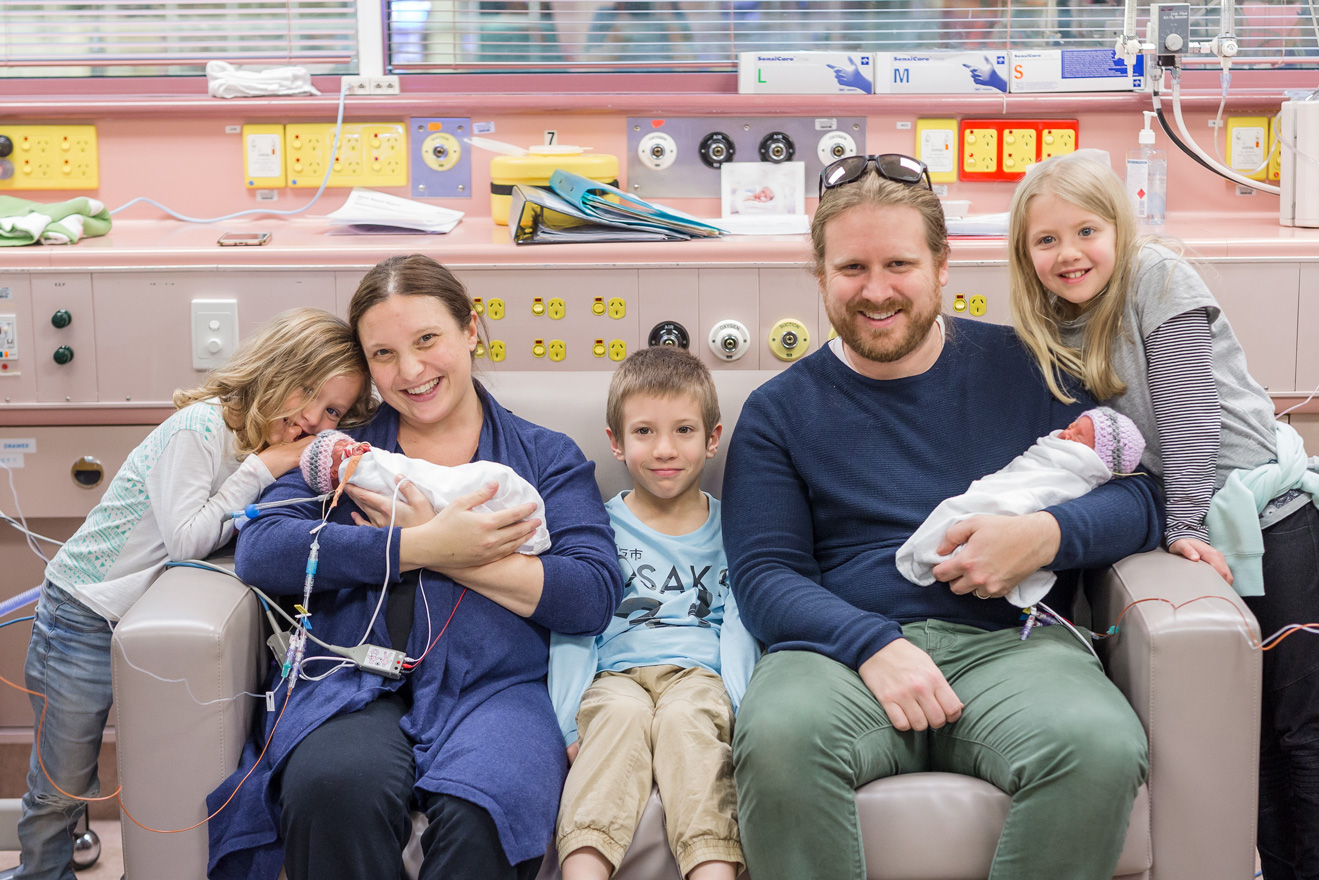 The Fleming family pictured as a family of seven in the Women's and Children's Hospital Neonatal Intensive Care Unit.