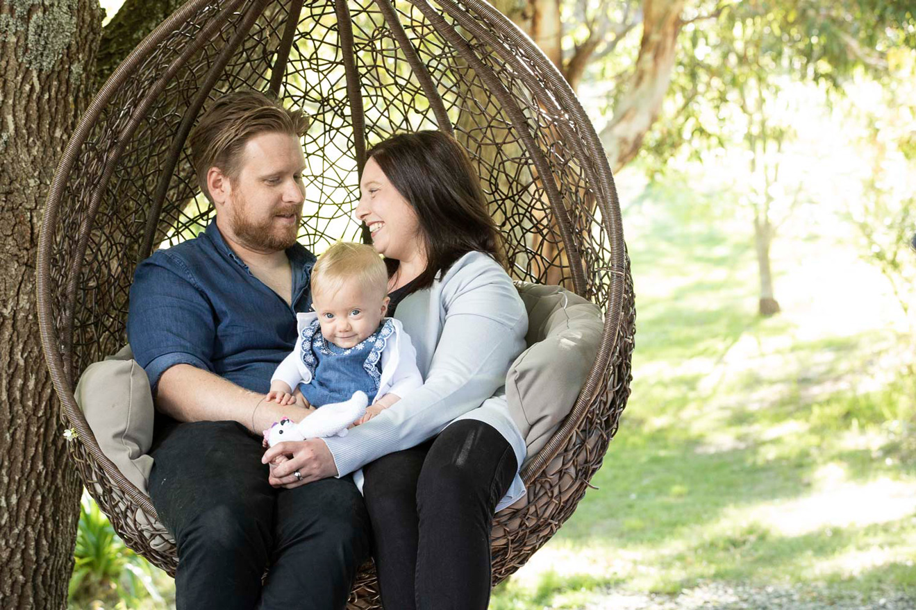 Shannon and Nicole Fleming pictured with one-year-old Eloise at their Adelaide Hills home.