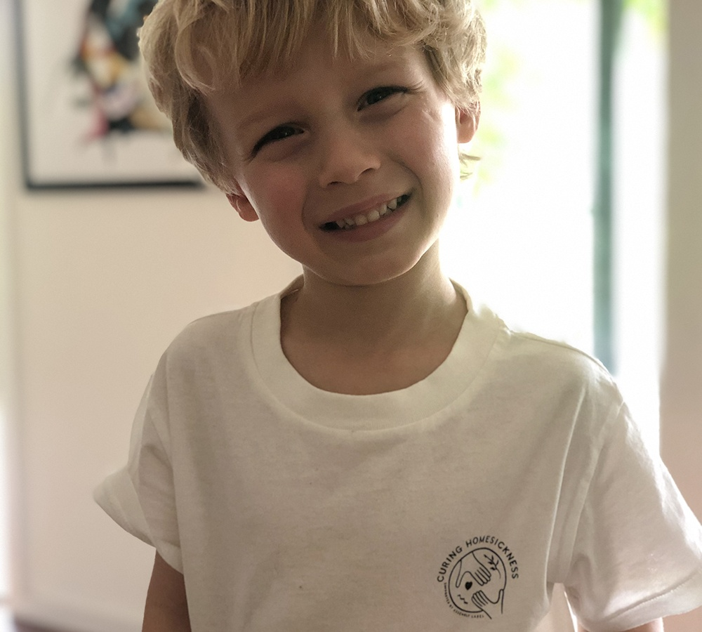 Young boy smiling.