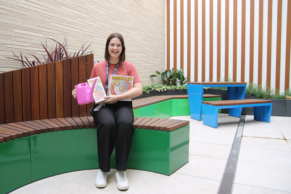 Lauren's Legacy : Play Therapist, Kate, in Mallee Ward's outdoor area with gardening and art supplies funding through the Lauren Corena Fund.