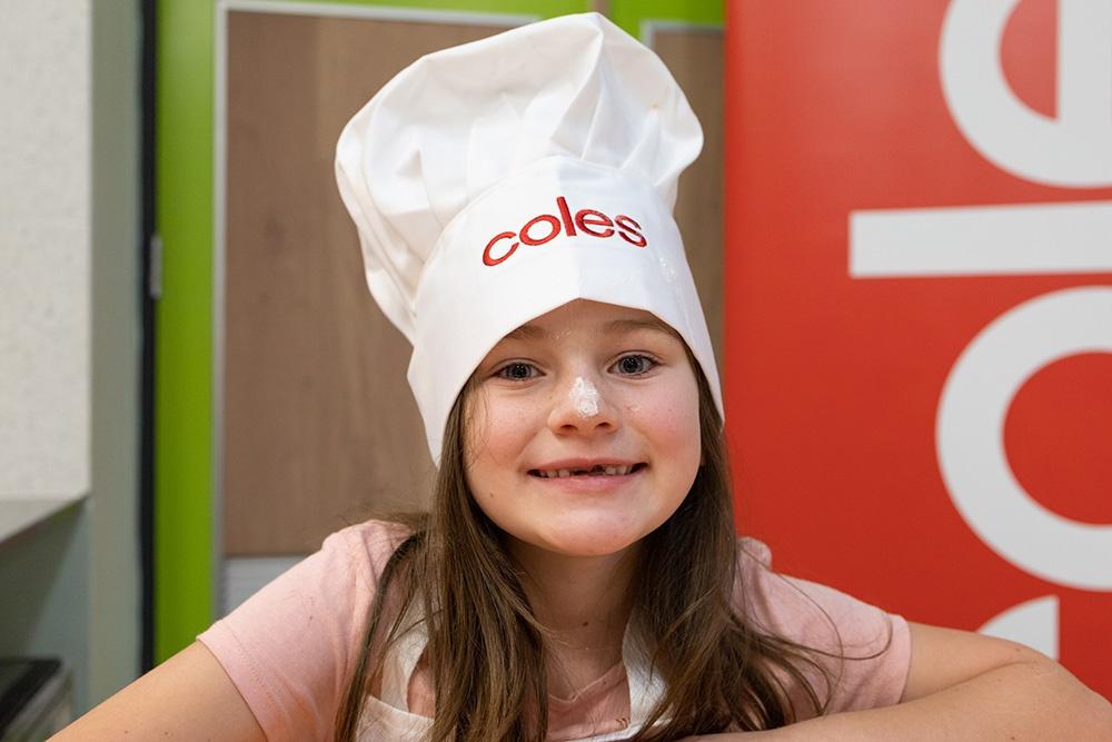 Melody (8) enjoying pizza making class.