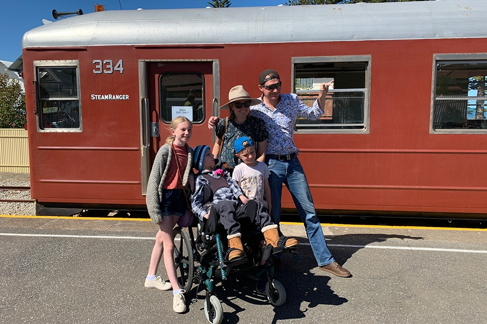 The Petrick family taking a trip on the Steam Ranger during their stay at the Beach House.