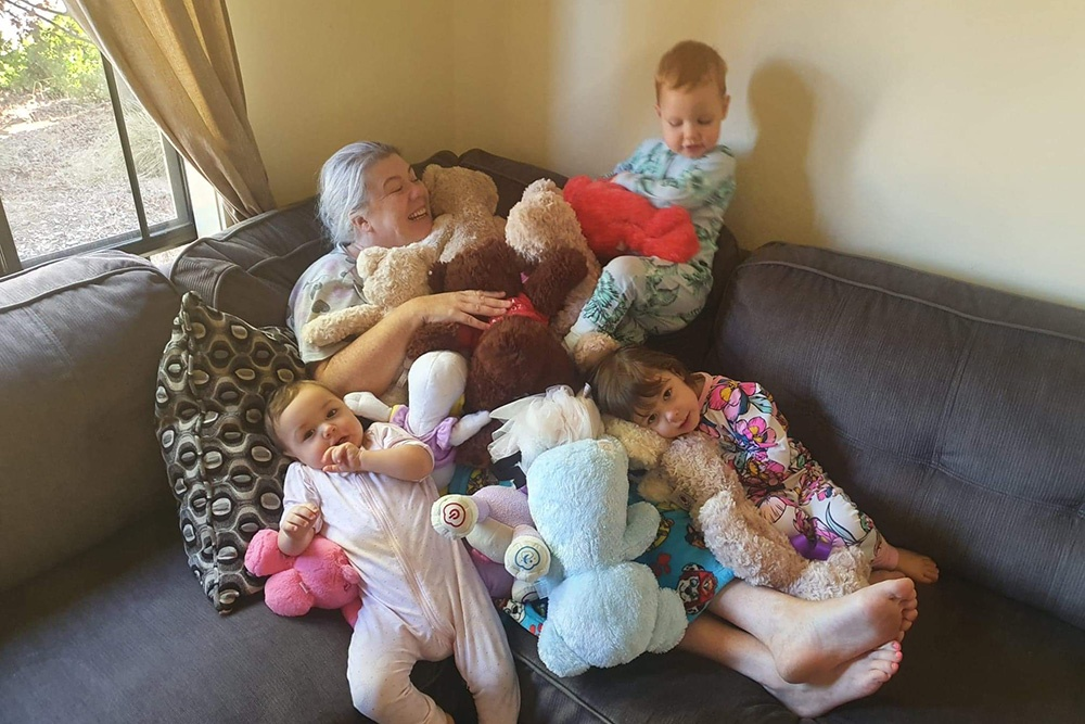 Nadine playing with her children.